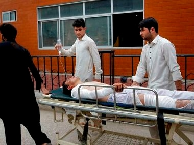 Volunteers transport a man to a hospital injured from an earthquake in Peshawar, Pakistan, Sunday, April 10, 2016. A powerful earthquake rattled Pakistan's capital and other cities across the country on Sunday, causing panic among people but with no immediate reports of casualties or major damages. Pakistani official Arif Ullah told The Associated Press that the magnitude-7.1 quake was centered near Afghanistan's border with Tajikistan. AP