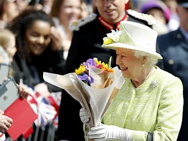 Britain's Queen Elizabeth II meets well wishers during a walkabout to celebrate her 90th birthday in Windsor, England on Thursday. AP