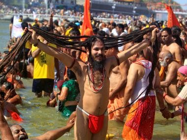 A Hindu holy man displays his hair after taking a dip in the waters of the river Shipra during the Simhastha Kumbh Mela in Ujjain. Reuters