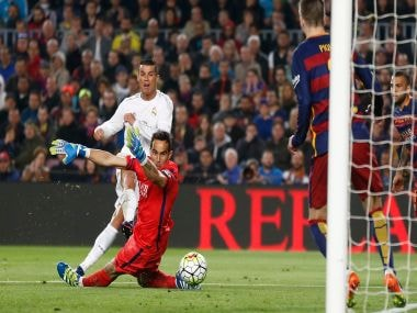 Cristiano Ronaldo scores his side's second goal past Barcelona goalkeeper Claudio Bravo. AP