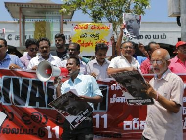 Sri Lankan journalists shout slogans holding a portrait of killed journalist Dharmeratnam Sivaram during a protest in Colombo. AP