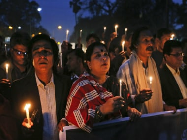 Bangladeshi people hold lighted candles and walk in a rally during Martyrs Day in Dhaka, Bangladesh. AP
