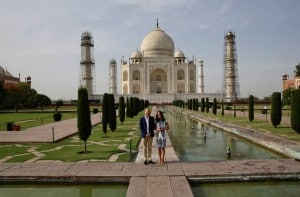 Britain's Prince William, along with his wife, Kate, the Duchess of Cambridge, pose in front of the Taj Mahal in Agra on Saturday. PTI<br />