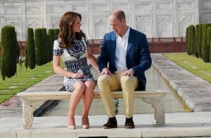 Britain's Prince William, along with his wife, Kate, the Duchess of Cambridge, talk to each other as they pose in front of the Taj Mahal in Agra on Saturday. PTI<br />
