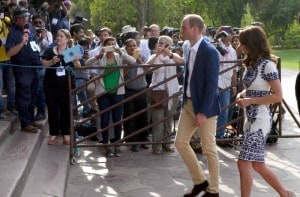Onlookers click pictures as Britain's Prince William, along with his wife, Kate, the Duchess of Cambridge, enter the Taj Mahal in Agra on Saturday. PTI<br />