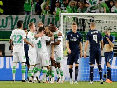 Wolfsburg's players celebrate after Ricardo Rodriguez scored the opening goal. AP