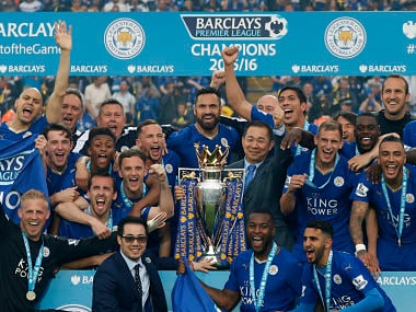 Leicester City players and Leicester City's Thai chairman Vichai Srivaddhanaprabha (C) pose with the Premier league trophy. AFP