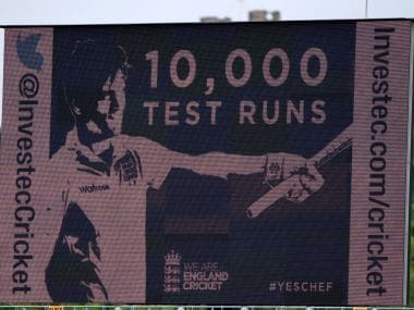 The giant scoreboard shows Alastair Cook after reaching 10,000 test runs. Getty