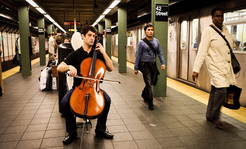 Dale Henderson plays in the Times Square subway station as part of Bach in the Subways Day. Image courtesy Daniella Zalcman