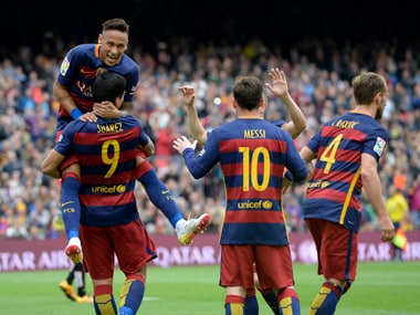 Barcelona's Luis Suarez celebrates with Neymar and teammates. AFP
