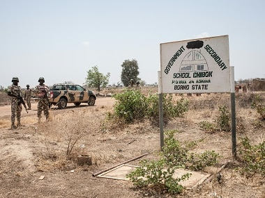 Nigerian Army soldiers stand outside the Government Girls Secondary School Chibok two years after the abductions took place. AFP