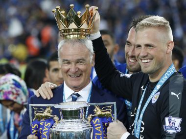 Leicester City's manager Claudio Ranieri poses with the Premier League trophy. AFP