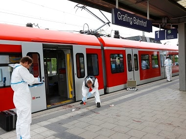 Police investigate the scene of a stabbing at a station in Grafing near Munich, Germany. AP