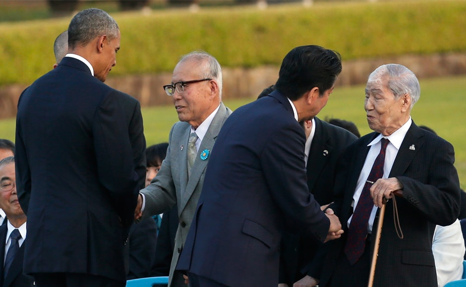 Barack Obama, second from left, greets Shigeaki Mori, an atomic bomb survivor, third from right, and Sunao Tsuboi, right, chairman of Japan Confederation of A-and H-Bomb Sufferers Organizations at the event. AP