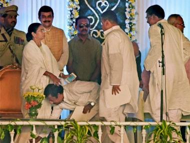 Bengal portfolios: Mamata keeps home, retains Mitra as finance minister