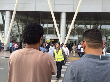 Egyptians gather outside the arrivals section of Cairo International Airport, Egypt. AP.