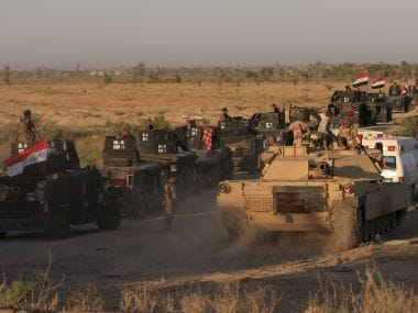 Iraqi military forces prepare for an offensive into Fallujah. AP