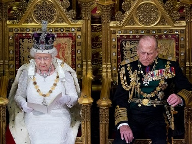 Britain's Queen Elizabeth II (L) sits beside her husband Prince Philip, Duke of Edinburgh, as she delivers the Queen's Speech during the State Opening of Parliament in London. AFP