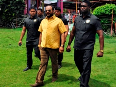 Pankaj Parakh, a municipal corporator, wears a shirt made of gold as he walks with his bodyguards to attend his birthday celebrations in Yeola, in the western Indian state of Maharashtra August 8, 2014. Local politician Parakh said it cost him $228,870 for the shirt, which is made of 18-22 carat gold, weighs 3.90 kilograms and took two months to be stitched, REUTERS/Stringer (INDIA - Tags: SOCIETY TPX IMAGES OF THE DAY) - RTR41PIT