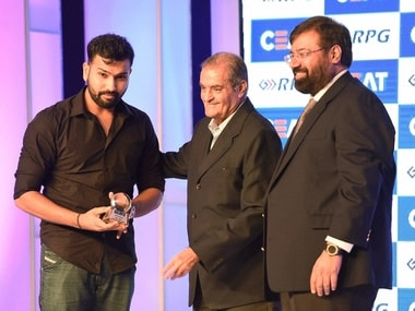 Rohit Sharma collects the Indian cricketer of the year award. PTI
