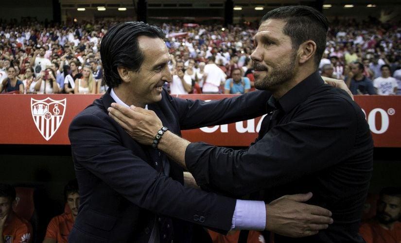 Head coach Unai Emeri of Sevilla FC embraces head coach Diego Pablo Simeone of Atletico de Madrid. Getty Images