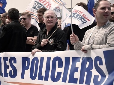 """Policemen demonstrate behind a banner reading """"Angry policemen"""" during a protest on Wednesday in front of a police station in the French eastern city of Strasbourg. AFP"""