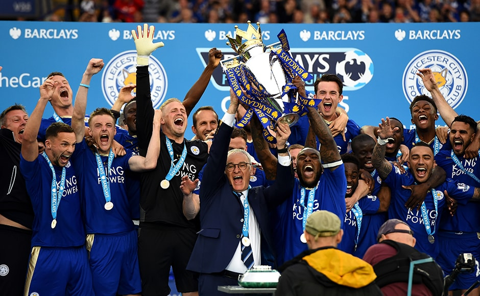 Captain Wes Morgan and manager Claudio Ranieri of Leicester City lift the Premier League Trophy after the Barclays Premier League match between Leicester City and Everton at The King Power Stadium on May 7, 2016 in Leicester, United Kingdom. Getty