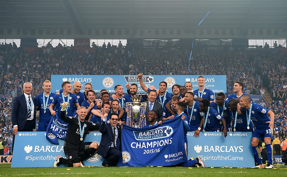 Leicester City players celebrate the season champions with the Premier League Trophy after the Barclays Premier League match between Leicester City and Everton at The King Power Stadium on May 7, 2016 in Leicester, United Kingdom. Getty