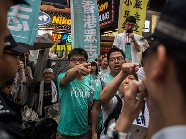 Demosisto member and pro-democracy leader Joshua Wong (C) and Nathan Law (top R) shout slogans during a standoff with police in Hong Kong. AFP