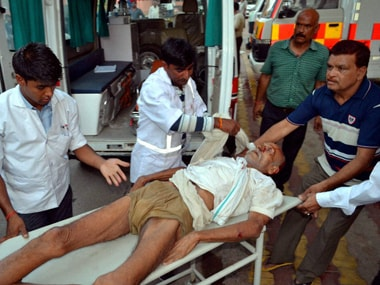 An encroacher being taken inside the District Hospital on a stretcher after he got injured during a clash in Mathura on Thursday. PTI
