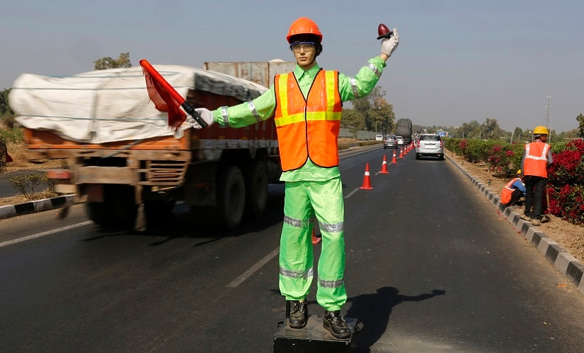 A robotic flagman signals to maintain traffic during maintenance and repairs on Ahmedabad-Delhi national highway on outskirts of Ahmedabad