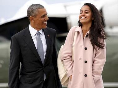 A file photo of U.S. President Barack Obama and his elder daughter Malia. Reuters