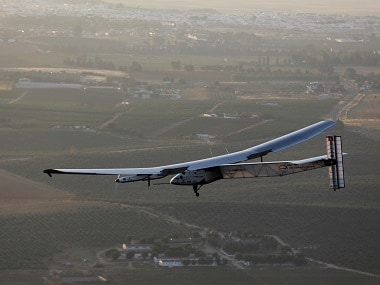 The solar-powered plane Solar Impulse 2 is pictured before landing at San Pablo airport in Seville. Reuters