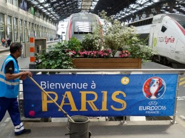 A worker passes by a welcoming banner for Euro 2016 during a national railway strike by French railway unions workers. Reuters