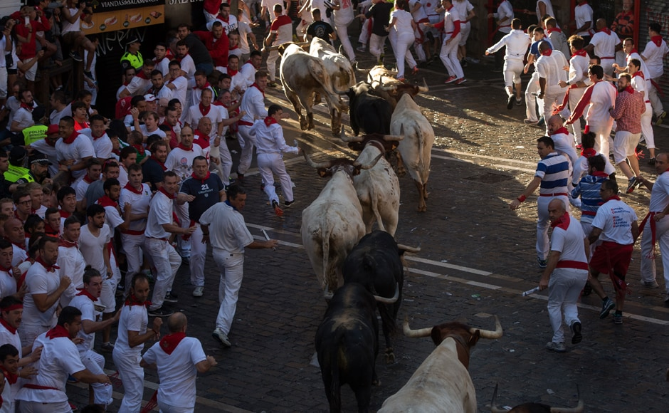 Participants run ahead of Fuente Ymbro fighting bulls on the first day of the San Fermin bull run on 7 July , 2016, in Pamplona, northern Spain. AFP.