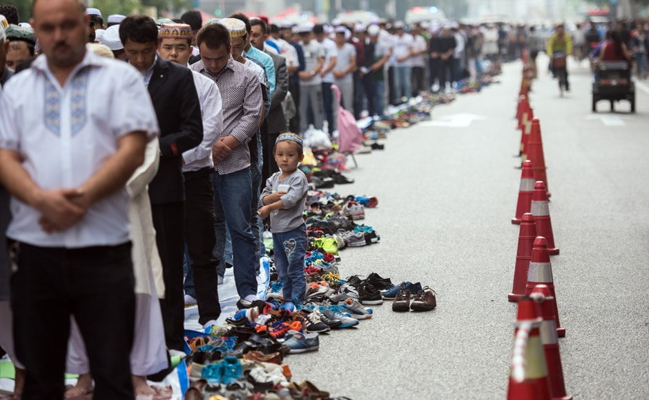 Chinese Muslims perform congregational Eid morning prayers on the streets near the Huxi mosque during the sacrificial Eid al-Adha festival in Shanghai . AFP