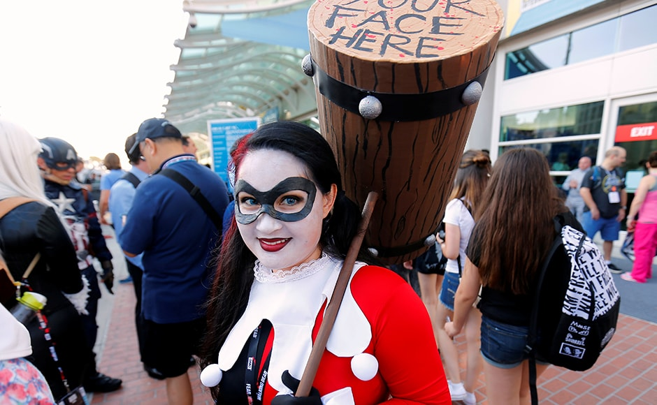 An attendee dressed as Harley Quinn arrives for at the Comic-Con venue. Reuters