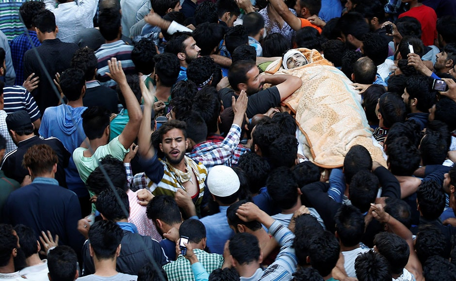 Kashmiri Muslims carry the body of Burhan Wani, a separatist militant leader, during his funeral in Tral, south of Srinagar on Saturday. Wani, 21, was killed on Friday along with two accomplices in a gunbattle with a joint force of army and police personnel at Kokernag area, 83 kms from Srinagar. Reuters