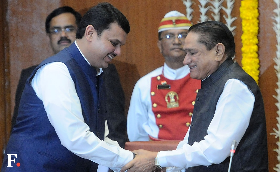 Pandurang Phundkar greets Maharashtra Chief Minister Devendra Fadnavis after taking oath as cabinet minister. He is a very senior leader close to the late Gopinath Munde and has previously occupied positions such as BJP state party president and Opposition leader in the legislative council. Sachin Gokhale/Firstpost