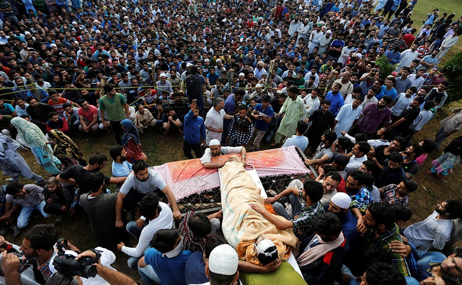 More than 20,000 people, who came from different parts of Pulwama district, gathered at Shariefabad (Tral) to attend the burial by defying curfew restrictions imposed by the authorities. Shouting pro-Islam and pro-Azadi slogans, mourners at the burial appeared surcharged as youths raised slogans vowing to follow Wani's path. The authorities withdrew all security forces deployed around the ground to prevent clashes with the agitated people. Reuters
