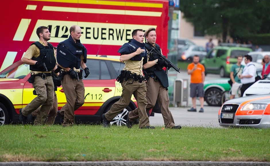 Police in Munich, Germany respond to a shooting at a shopping center in the city on Friday. Cops confirmed that shots were fired at Olympia Einkaufszentrum shopping center. At least eight people have been confirmed dead but the number of injured is yet to be ascertained. DPA via AP