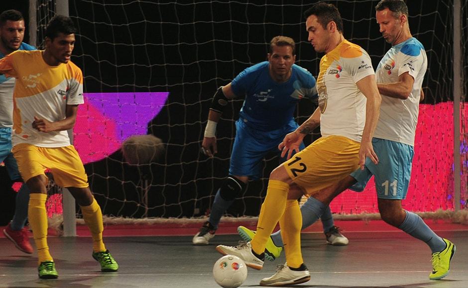 Alessandro Rosa Viera (2R), also known as Falcao, from the Chennai 5's plays against the Mumbai 5's during their Premier Futsal Football League match in Chennai on July 15, 2016. (ARUN SANKAR / AFP)