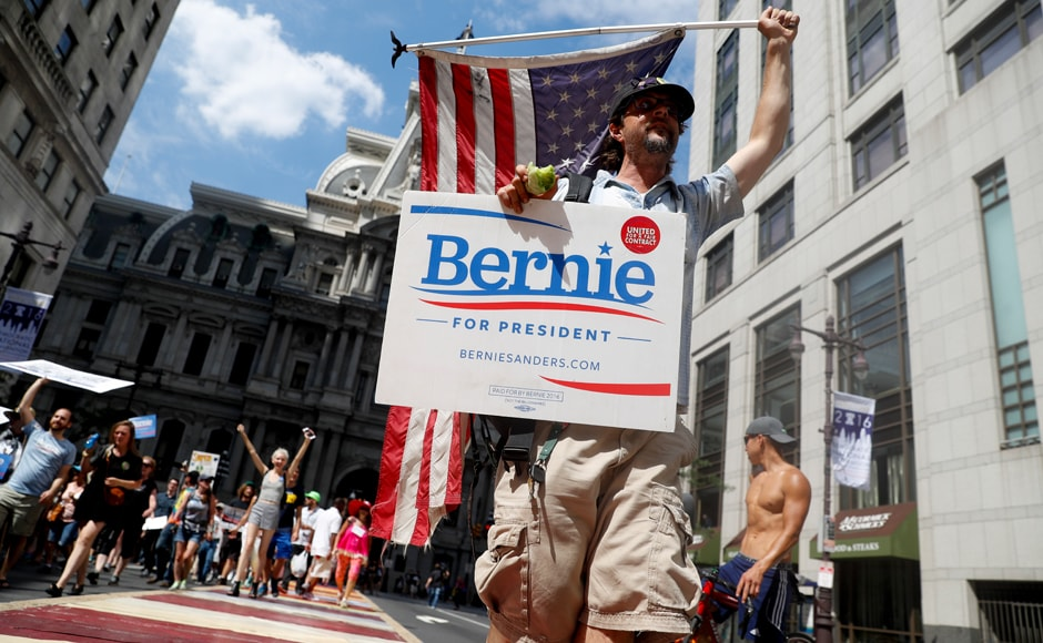 Supporters of Sen. Bernie Sanders, who lost the Democratic primaries to Hillary Clinton, march during a protest in downtown Philadelphia. A trove of embarrassing leaked emails which some said reveal an anti-Sanders bias at the supposedly neutral Democratic National Committee, has ripped open the barely-healed primary wound. AP