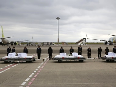 Japanese Foreign Minister Fumio Kishida, third left, with other officials, bows in front of the coffins of the victims who were killed in the Dhaka Attack. AP