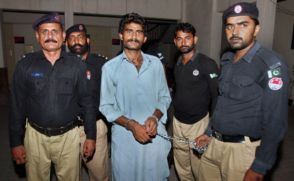 """Pakistani police officers present Waseem Azeem, the brother of slain model Qandeel Baloch, before the media following his arrest at a police station in Multan, Pakistan, Sunday, July 17, 2016. Pakistani police say the brother of slain model Baloch has confessed to strangling her to death for """"family honor"""" because she posted """"shameful"""" pictures on Facebook. (AP Photo/Asim Tanveer)"""
