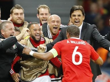 Wales coach Chris Coleman and Ashley Williams celebrate the centre-back's goals. AP