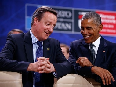 US President Barack Obama speaks to British Prime Minister David Cameron during the Nato Summit in Warsaw. Reuters