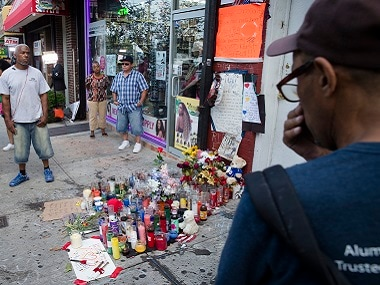 File photo of pedestrians at a memorial for Eric Garner at the site where he died while being arrested by New York City police, in Staten Island. AP