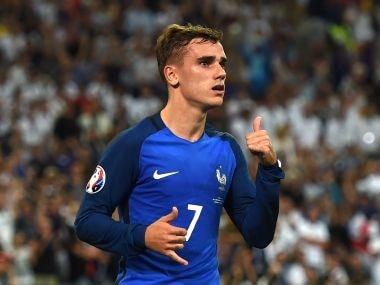 France's forward Antoine Griezmann celebrates after scoring a penalty. AFP