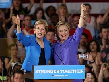 Hillary Clinton (R) stands along side US Senator Elizabeth Warren at a campaign rally in Cincinnati, Ohio. Reuters